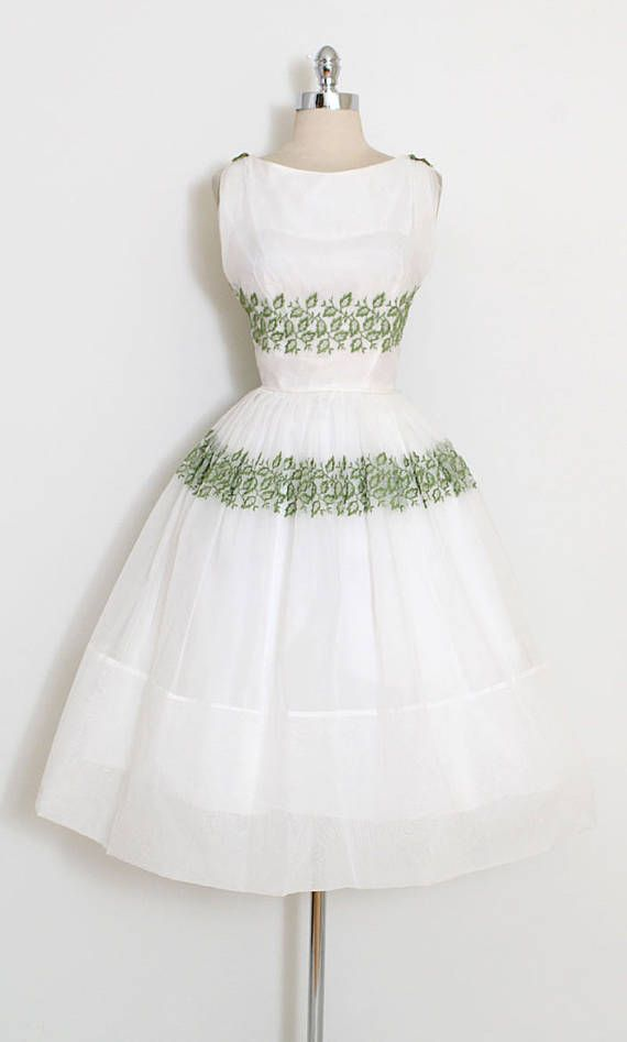 ➳ vintage 1950s dress * gorgeous white chiffon dress * green embroidered leaves * velvet ribbon shoulder bows * acetate lining * metal back zipper condition | excellent fits like large length 45 bodice 17 bust 40 waist 30-31 some clothes may be clipped on dress form to show best fit for appropriate size. ➳ shop http://www.etsy.com/shop/millstreetvintage?ref=si_shop ➳ shop policies http://www.etsy.com/shop/millstreetvintage/policy twit...