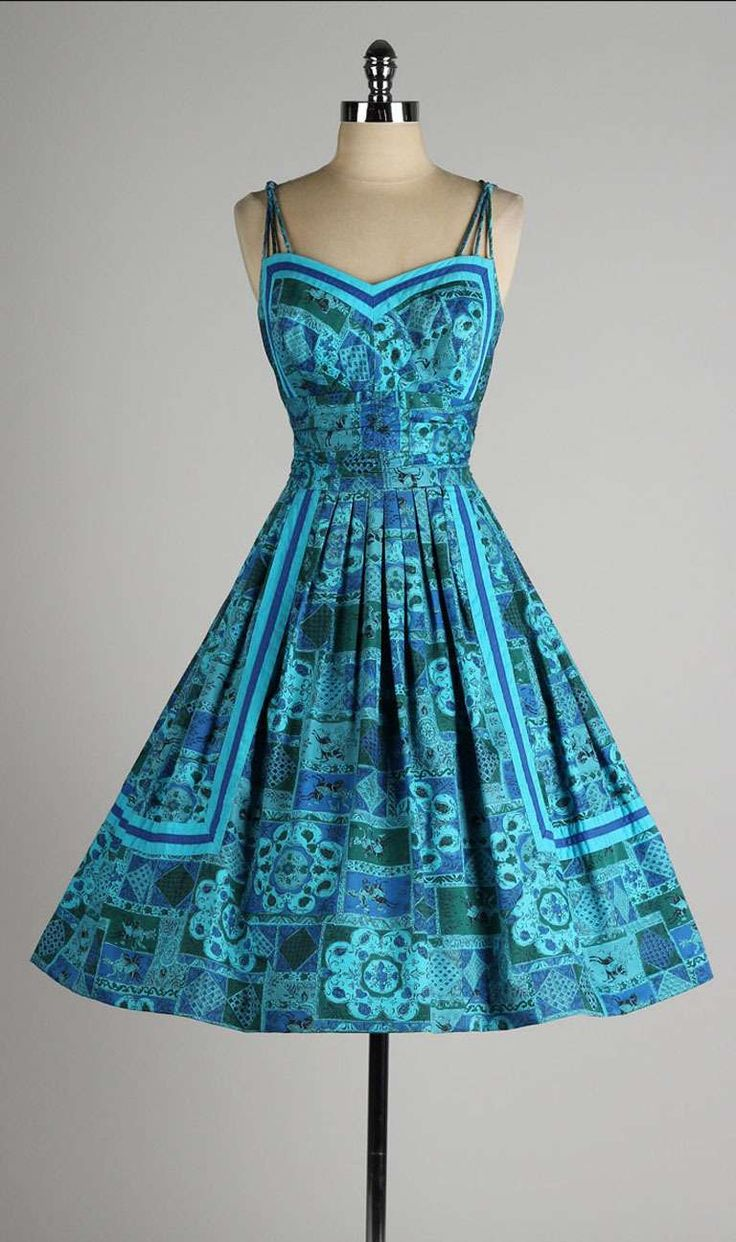 Vintage 1950's Blue Floral Cotton Alix of Miami Dress | From a collection of rare vintage day dresses at http://www.1stdibs.com/fashion/clothing/day-dresses/