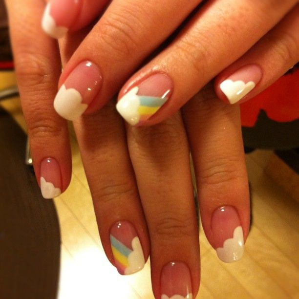 Reminds me of when I was nine. Rainbows, clouds, and...wait, we need a unicorn here. <-she basically means rainbow dash nails. And the unicorn being twilight