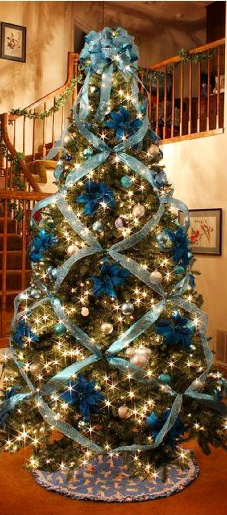 Christmas Tree Ideas - Criss Cross Ribbon when decorating your tree - it's gorgeous!