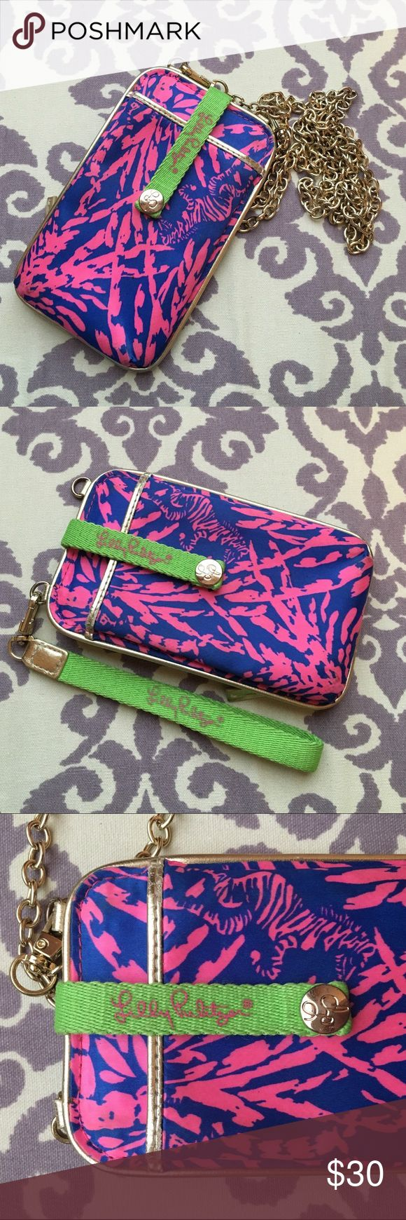 "Lilly Pulitzer Wristlet/Crossbody This versatile little guy is an easy accessory for any outing.  //  Print is Sapphire Blue ""Rollin In The Grass."" Used only a few times. Has an ID window and coin/money/card slot. Comes with a wristlet and gold chain for turning it into a small crossbody measuring at 54"" (27"" when doubled up/worn). There's a place to hold your phone (fits iPhone 4/4s/5/5s with case on, fits iPhone 6/6s when bare or with a very slim case). Lilly Pulitzer Bags Clutches…"