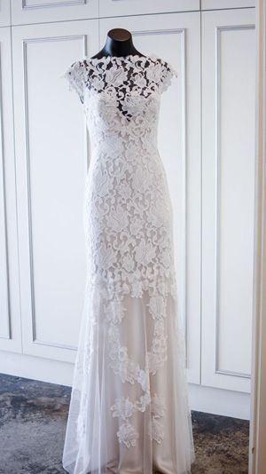 Gorgeous lace wedding dress, with a simple slim cut to emphasise the beauty of the decorations, by Rapsimo