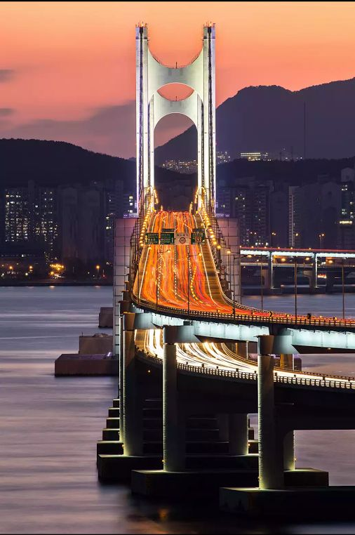 The Gwangan Bridge or Diamond Bridge is a suspension bridge located in Busan, South Korea. It connects Haeundae-gu to Suyeong-gu. The road surface is about 6,500 meters long, with the bridge as a whole spanning 7,420 meters. It is the second longest bridge in the country after the Incheon Bridge.