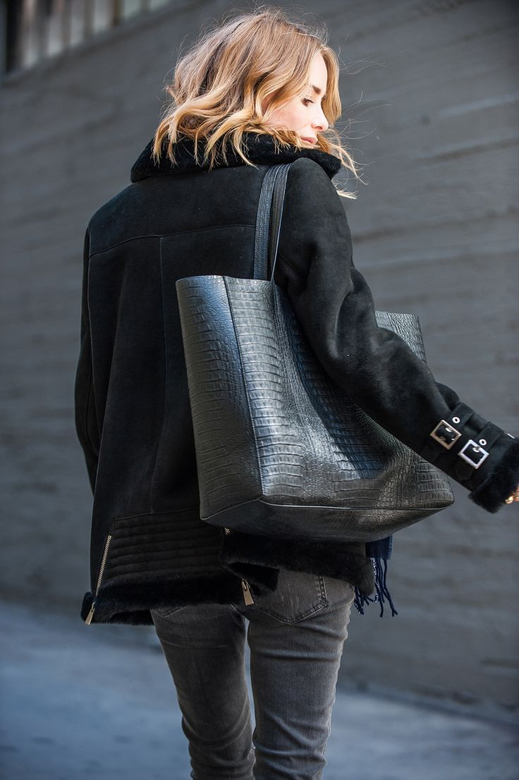 Anna Mariawears a black shearling coat with skinny jeans and accessorises with a faux crocodile skin handbag.Coat/Jeans/Bag: Anine Bing.