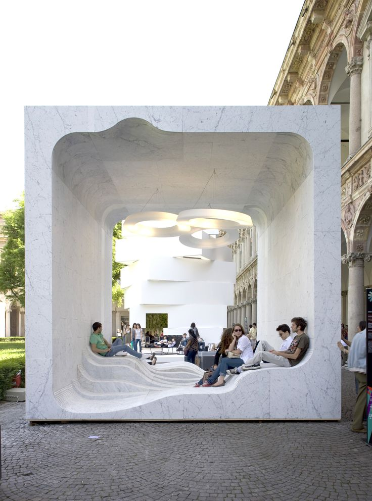 """Designed for the """"Mutant Architecture and Design"""" presentation by interiors magazine Interni at Milan's 2011 Design Week, this open-air marble cube features a hollow interior with an undulating floor to provide seating and lounge space. Dubbed Zero by Snøhetta, the installation was inspired by a large, hollowed-out room at a marble quarry visited by the architects."""