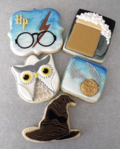 Harry Potter Themed cookies. These sugar cookies are decorated with royal icing! We have a Harry Potter Logo cookie, a mug of Butter Beer, A detailed Golden Snitch, a Sorting Hat, and Hedwig, Harry Potters Owl.  These were a fun bunch of cookies to create!