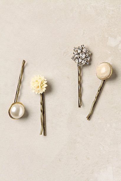 I'd love to use little vintage earrings and etc. to hot glue to my bobby pins! How cute!
