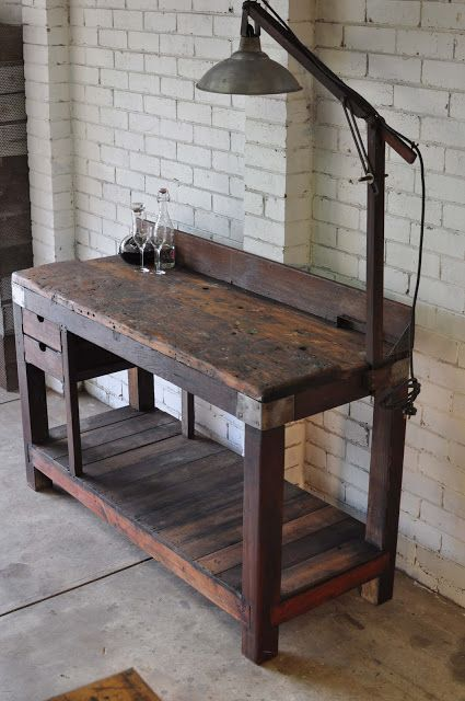 Rustic industrial workbench. Pretty cool.