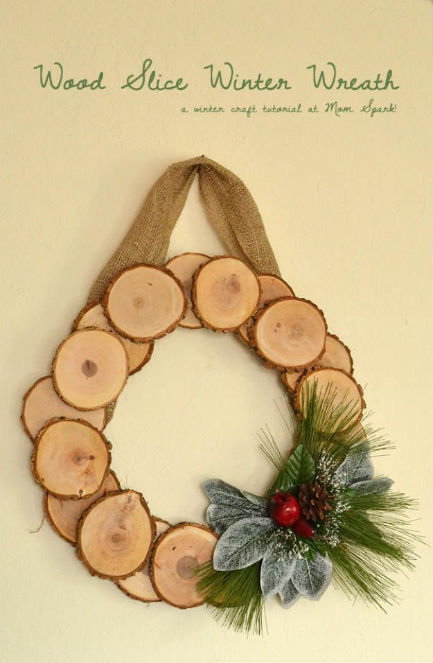 Wood Slice Winter Wreath   Awesome Wood Crafts to Beautify Your Home This Winter