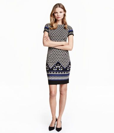 Fitted dress in textured jersey with short sleeves, seam at waist, and a visible back zip. Unlined.