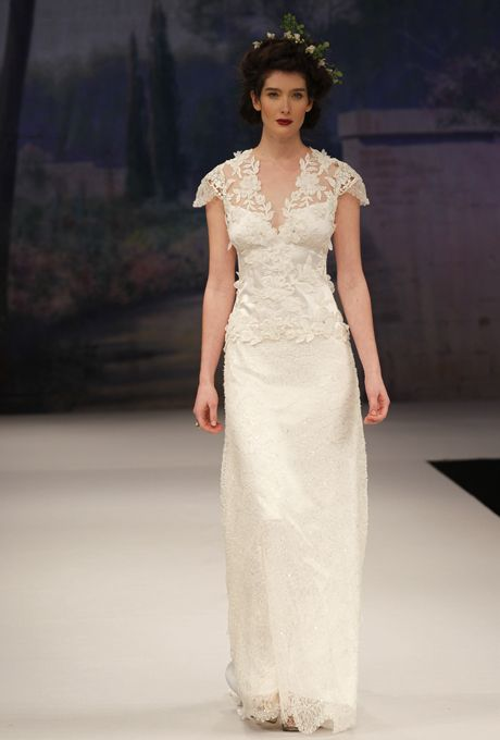 "Brides: Claire Pettibone - Fall 2012. ""Belle"" lace sheath wedding dress with an illusion v-neckline, cap sleeves, and floral details, Claire Pettibone"