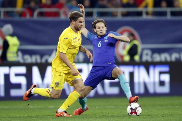 Eric Bicfalvi of Romania Daley Blind of Holland during the friendly match between Romania and The Netherlands on November 14 2017 at Arena National...