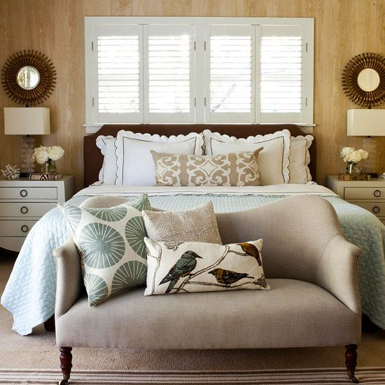 Bed placement under windows, nightstands, bench, pillows, color, lamps, mirrors