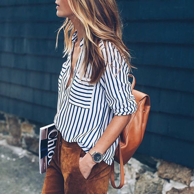 Chic casual street style. Relaxed cut blue and white stripe shirt rolled sleeves. Tan slant pocket pant
