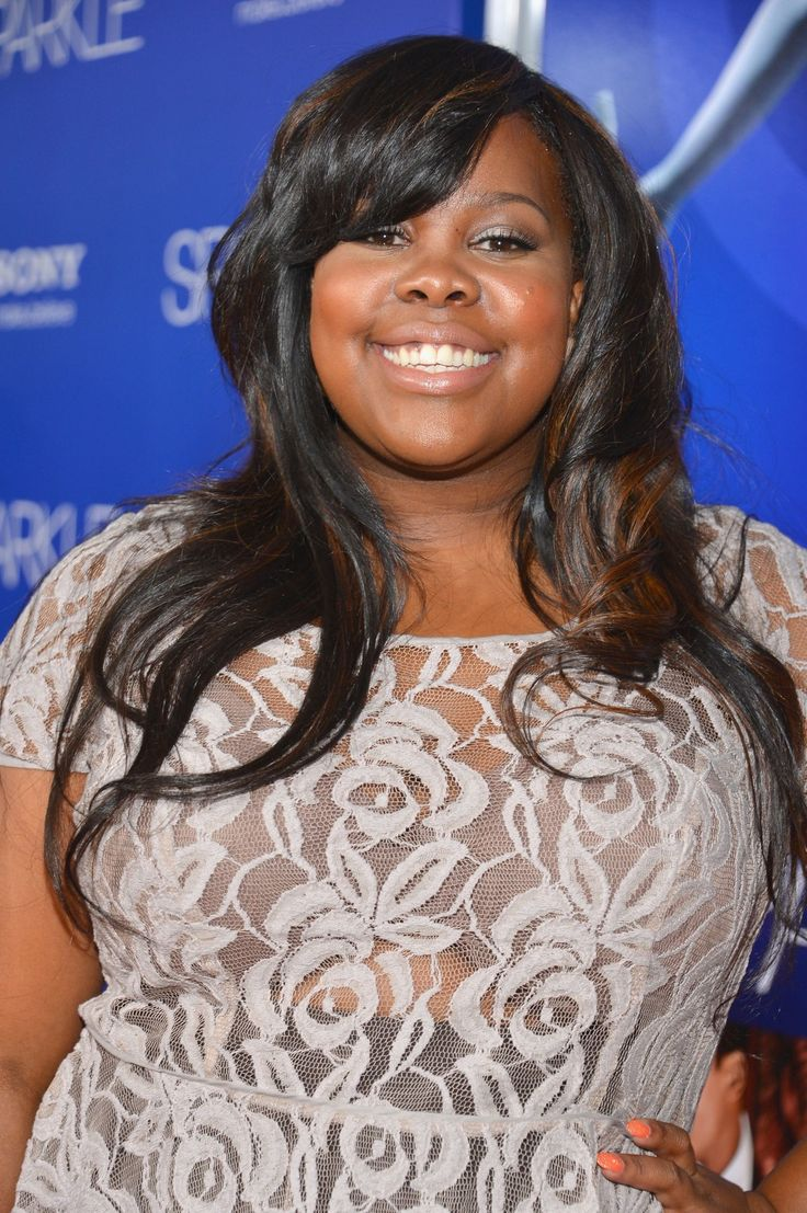 "If you want bouncy side-swept bangs like Amber Riley's, ""ask for fringe that will fall just above the eyebrows after you style them,"" says celeb stylist and beauty blogger Kristan Serafino. The best part? ""It can work on any hair texture and is so easy to maintain."" Just use a dab of defrizzing shine serum and blow-dry with a large round brush to get a voluminous finish."