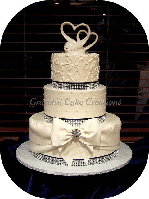 Elegant White Wedding Cake with Crystal Ribbon and Navy Blue Accents by Graceful Cake Creations, via Flickr