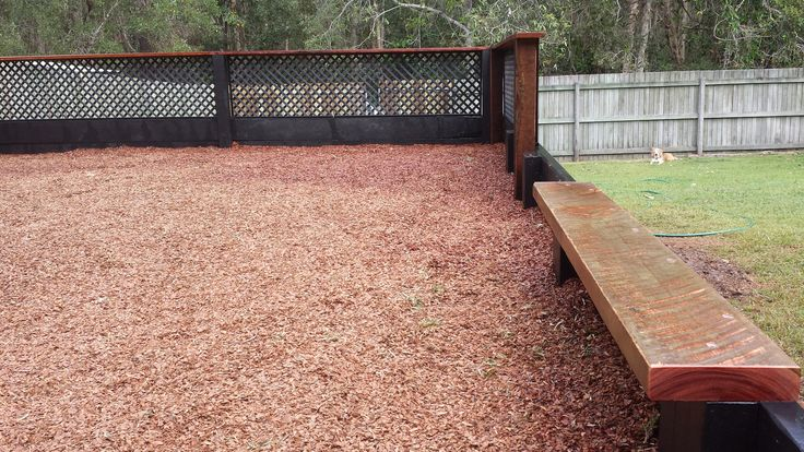 Sleeper retaining walls surround this play area filled with soft fall mulch. Built to house a trampoline as well as an outdoor play center/cubby house. Hardwood timber rails and steel latice protect the drop off on the raised side and the hardwood sleeper seat gives parents a place to sit whilst watching the kids play. Follow EcoBuilt on Facebook