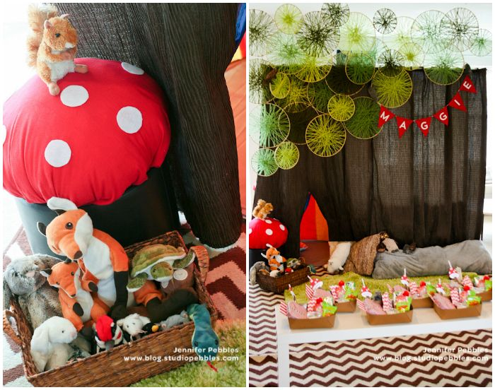 Wild & Woodsy birthday party by Jennifer Pebbles: modern tree backdrop includes brown crinkle fabric shower curtains (Target) hung from the ceiling and multiple sizes of embroidery hoops wrapped in yarn.  Ottomans were transformed into toadstools with inexpensive felt.