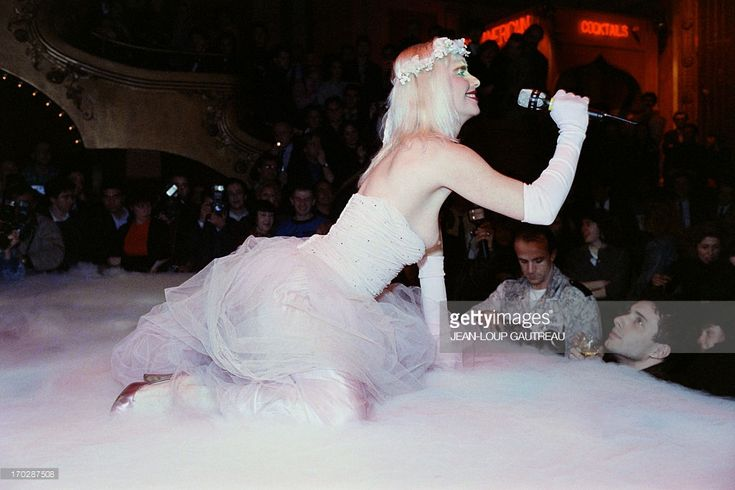 An archive portrait taken on January 28, 1988 shows Ilona Staller, known as Cicciolina, Italian porno-star and member of Italian Parliament, performing on the stage of the nightclub Le Palace  in Paris.  AFP PHOTO JEAN-LOUP GAUTREAU        (Photo credit should read JEAN-LOUP GAUTREAU/AFP/Getty Images)