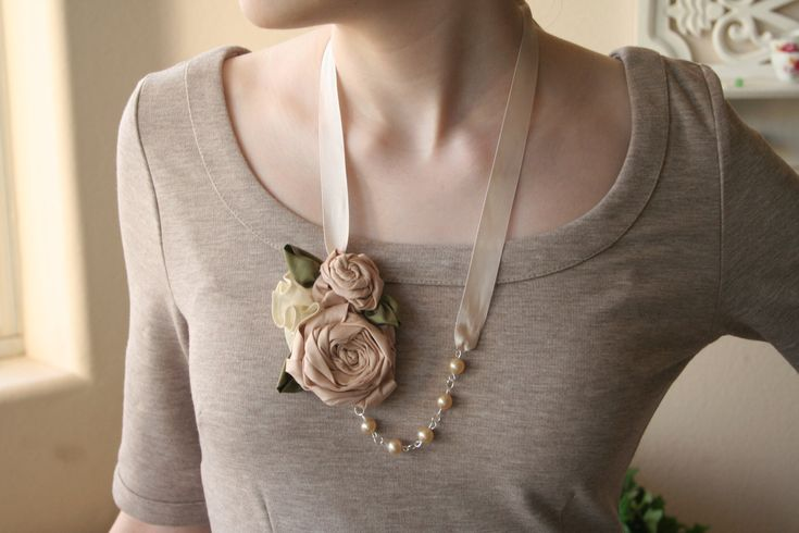 Fabric flower necklace. 'Ashley'  A unique vintage inspired design featuring hand made silk flowers, pearls, and satin ribbon.. $18.50, via Etsy.