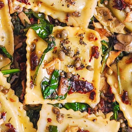 Jump to Recipe Print RecipeItalian Ravioli with Spinach, Artichokes, Capers, Sun-Dried Tomatoes. The vegetables are sautéed in garlic and olive oil. Meatless, refreshing,Mediterranean style pasta recipe that doesn't need any meat – this meal will keep you full! For this recipe, I used store-bought ravioli stuffed with pesto. You can also use cheese stuffed ravioli,...Read More