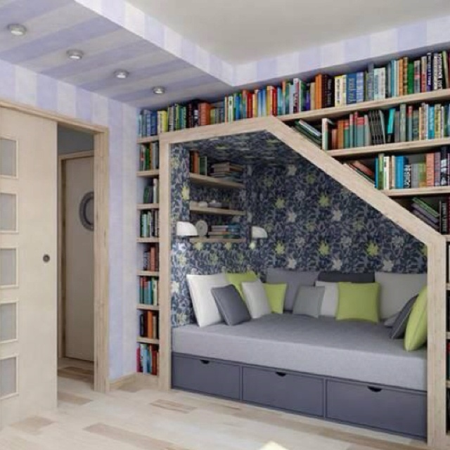 Nice use of under stairs space. Cozy too!