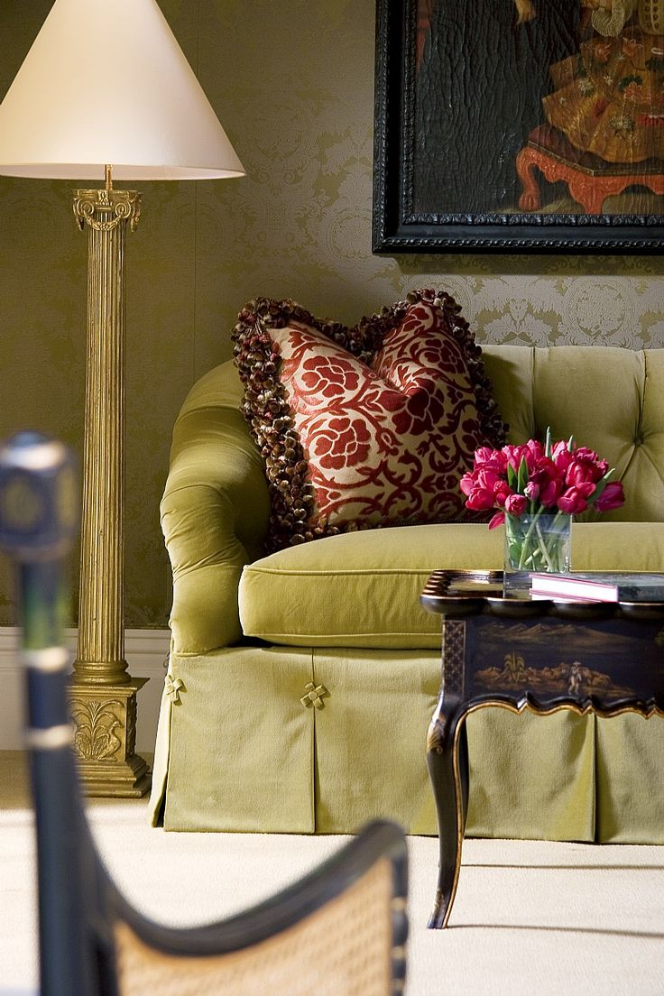 love the detail on the sofa's skirt.