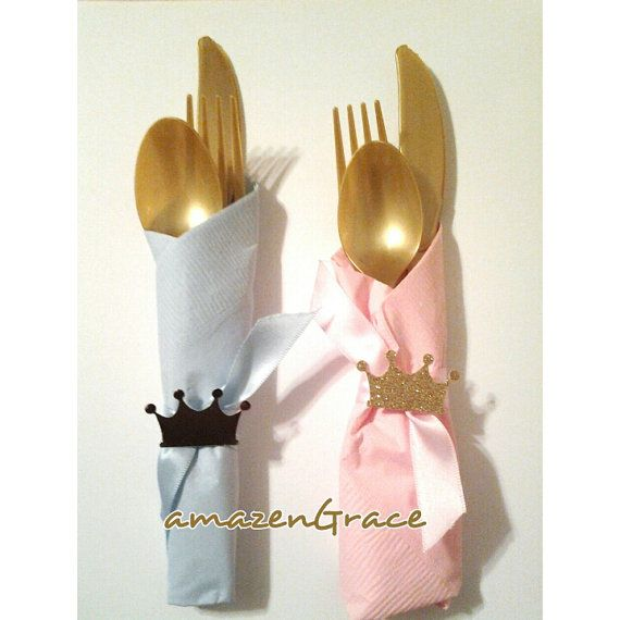 This listing is for 12 pre-made plastic cutlery sets. Each set includes a gold knife, spoon and fork. Each set is rolled in a pink or light blue napkin and tied closed with pink or light blue ribbon and each set is finished with a crown or tiara.. These cutlery sets are great for any royal prince and princess themed party for twins, friends, siblings, gender reveal baby showers, etc. CROWNS CAN BE MADE IN SILVER AND GOLD.       PLEASE INCLUDE YOUR EVENT DATE AND COLORS TO YOUR EVENT ALL…