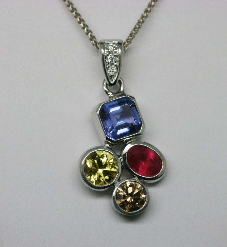 Birthstone pendant Birthstone pendant with Argyle white diamonds in the bale and featuring Tanzanite, Qld yellow Sapphire, fair trade ruby and Argyle cognac diamond handmade in recycled 18 carat white gold. Updated for the new baby.