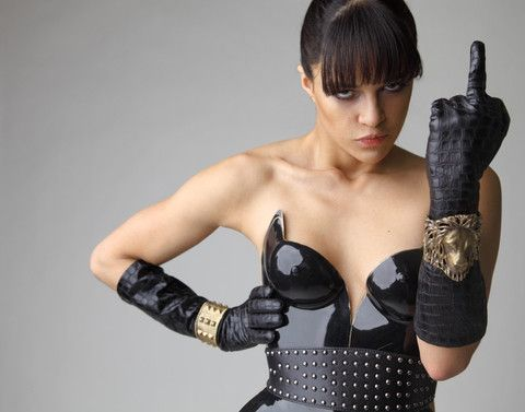 Actress Michelle Rodriquez looks fierce while posing in both the Lion Cuff & the Stud & Button Cuff designed by Alkemie. Get your own at VogueVert.com