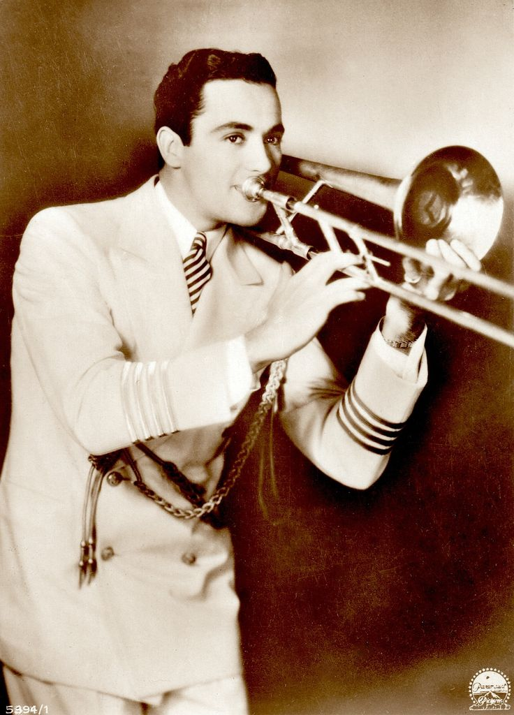 """CHARLES 'Buddy' ROGERS playing the trumpet 1930's -40's """"ross"""" sepia postcard (sans border)  Silent star, 30's-40's actor/singer/jazz musician/bandleader married silent legend Mary Pickford who was 12 years his senior (please follow minkshmink on pinterest) #buddyrogers #bandleader #silentstar #jazzmusician"""