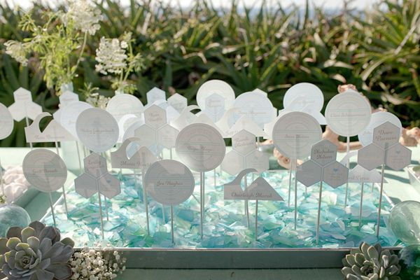 beach wedding escort cards with scale pattern