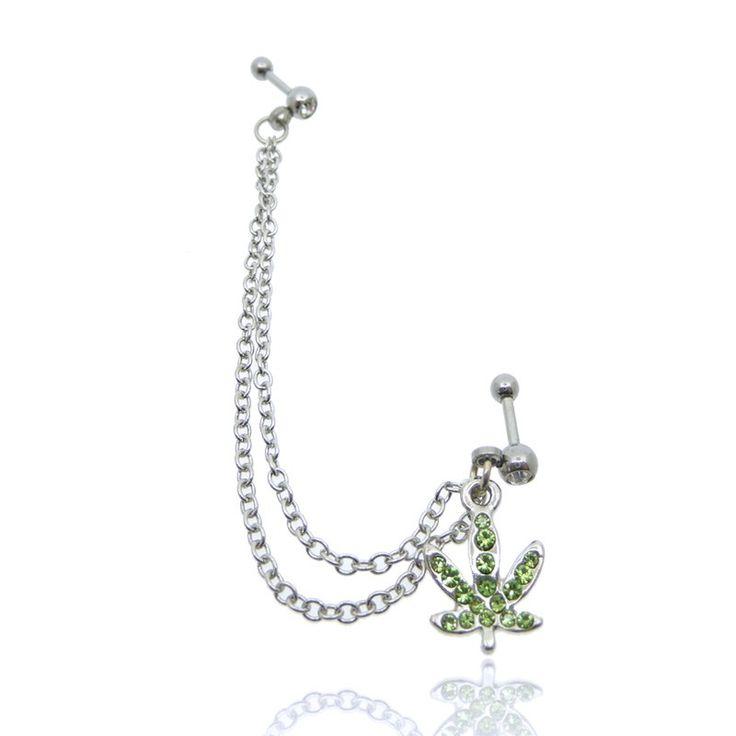 Constitué de 2 barres droites avec boules, de 2 chainettes pendentives et d'une feuille cannabis, ce bijou se porte au lobe et cartilage.