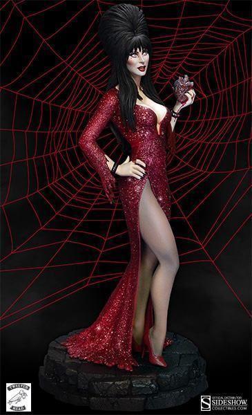 """A Tweeterhead anunciou uma nova estátua de Elvira, apresentadora do programa """"Elvira's Movie Macabre"""" nos anos 80, onde fazia comentários sobre filmes de horror trash. A Elvira """"Your Heart Belongs to Me"""" Maquette, em escala 1:6, captura a Rainha das Trevas usando um vestido longo vermelho sangue brilhante com glitter, com enorme decote na perna,…"""