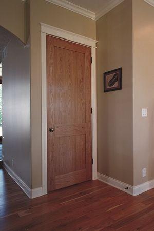 Interior Doors | two panel oak door with white mouldings | Bayer Built Woodworks
