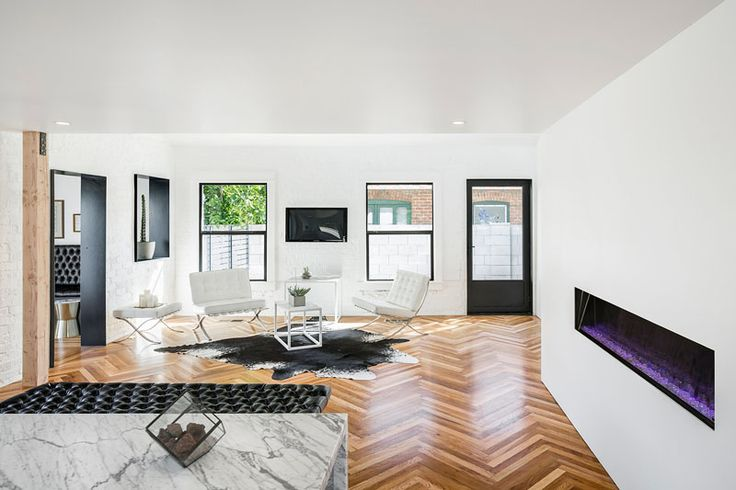 The original linear wood flooring of this home was salvaged and made into a herringbone pattern.