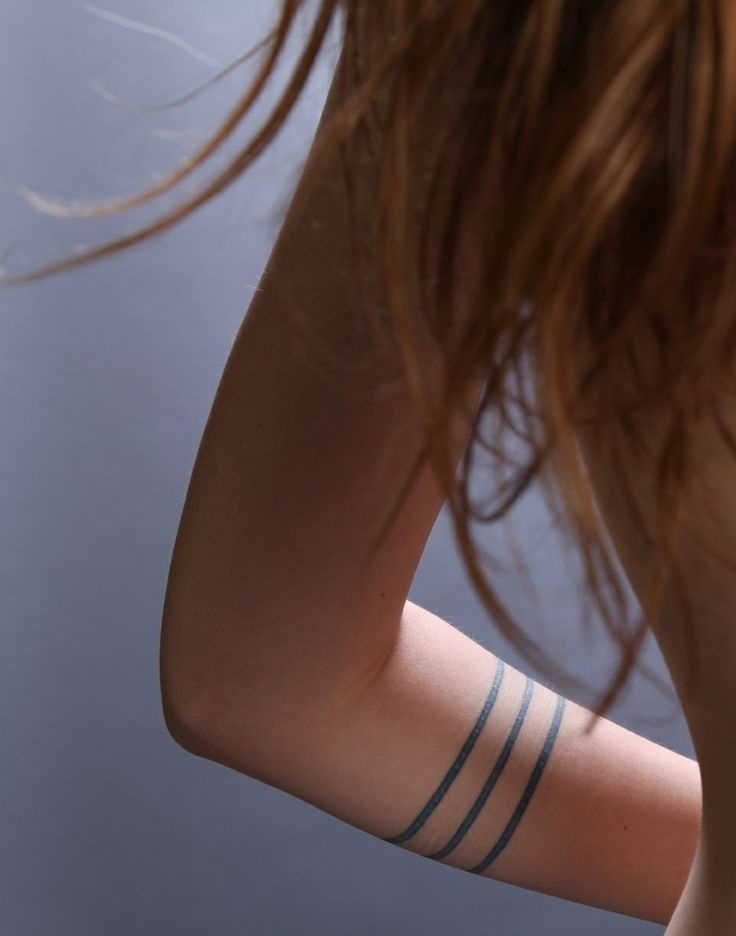 Three Thin Bands Tattoo: you'd have to be a certain type to pull this off.  Though I like that it looks like tribal bangles...and not a dated tribal armband