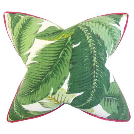 Add exotic appeal to your favorite chaise or arm chair with this eye-catching cotton pillow, showcasing a palm frond motif and red welt.