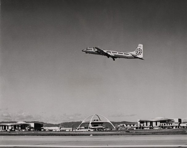 Throwback Thursday to when a Flying Tiger Line, America's first scheduled cargo airline in 1945 that later merged with Federal Express, takes off into the sky from the 12,000-foot runway on the south side of LAX. [PIC]: LAWA
