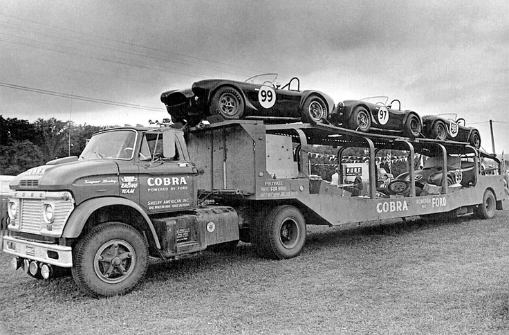 Ford N Tractor with fifth wheel car hauler working as a