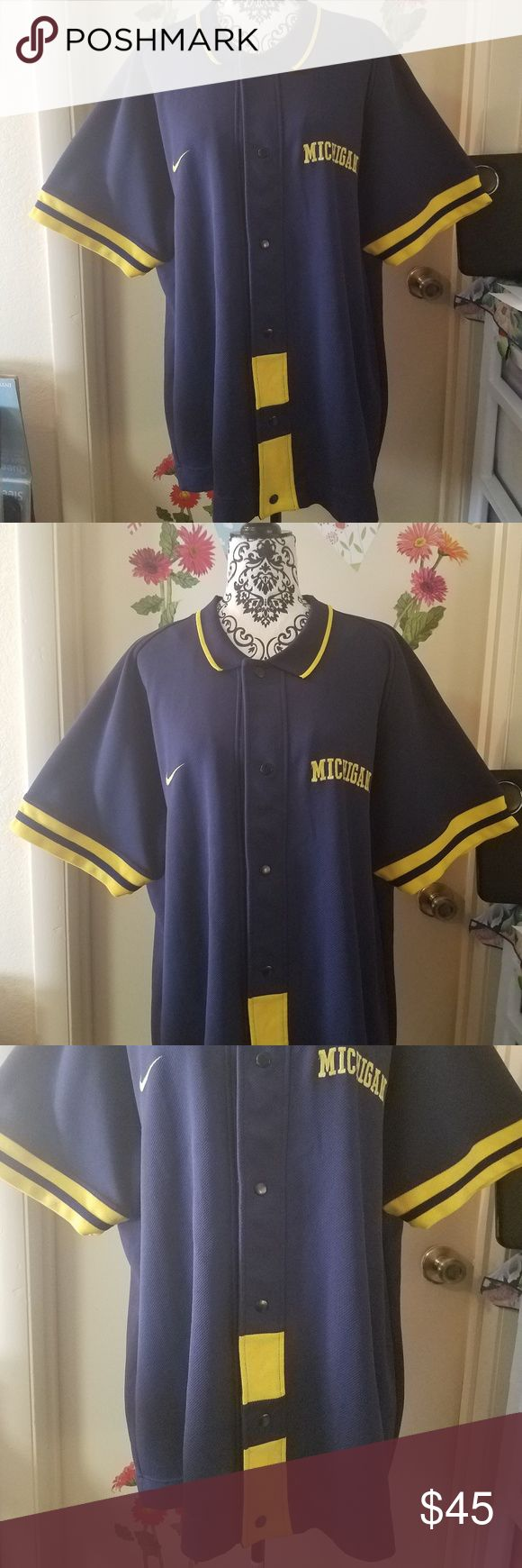 """TEAM NIKE SPORTS Snap On Michigan Jersey Shirt XL TEAM NIKE SPORTS Snap On Michigan Jersey Shirt Men Blue Yellow Polyester XL Excellent Used Condition   Nice baseball snap on jersey baseball shirt   94% Polyester  6% Cotton   Measurements:  Length: 33"""" in Chest: 27"""" in  Thank you for looking!  GB-T01 Nike Shirts Casual Button Down Shirts"""