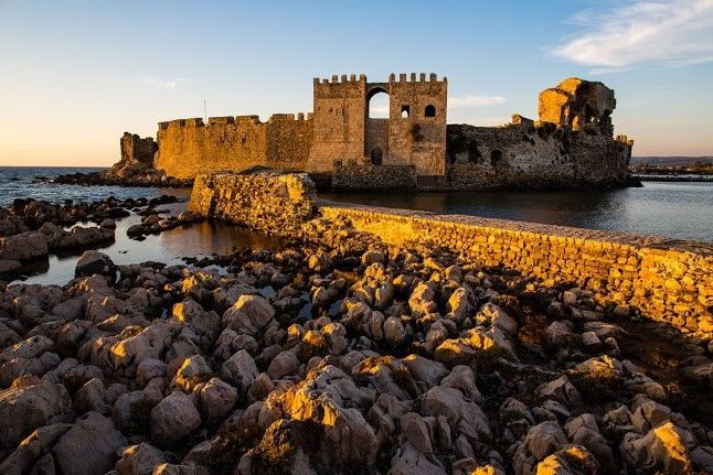 The castle of Methoni - one of the most distinctive castle-communities in Greece. It was built in 1209 by the Venetians on a rock that protrudes into the sea and is separated from the mainland by an artificial moat. #Greece #Messinia #Terrabook #Travel #GreeceTravel #GreecePhotografy #GreekPhotos #Traveling #Travelling #Holiday