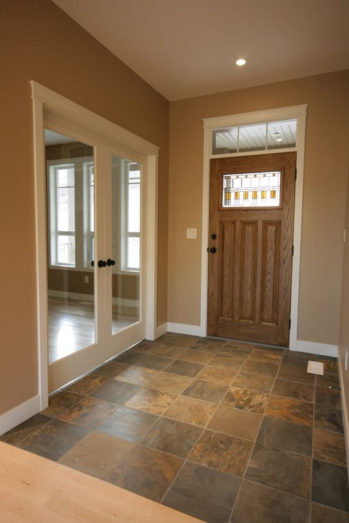 Use doors on office side Entryway with multi-coloured tile that compliment the door and paint colors