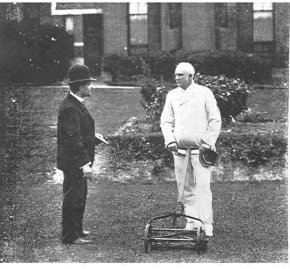 """PH 7806.  At """"Homeden"""", in Lansell Road, Toorak, Mr. Justice Hodges is being interviewed by a reporter as he was mowing the lawn at the front of his residence; c.1904."""