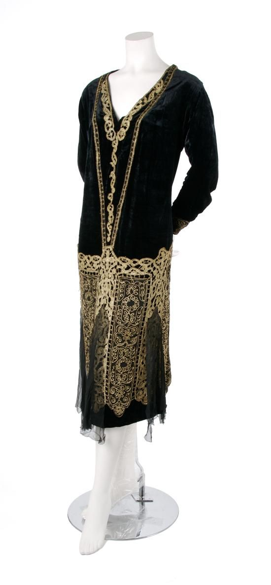 ~A Black Velvet and Gold Embroidered Evening Gown, 1920s, with gold thread embroidery throughout, a V-neckline, black chiffon panels at hem...~