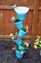 I am so going to make one for the back yard.  If I can find the pots that is...