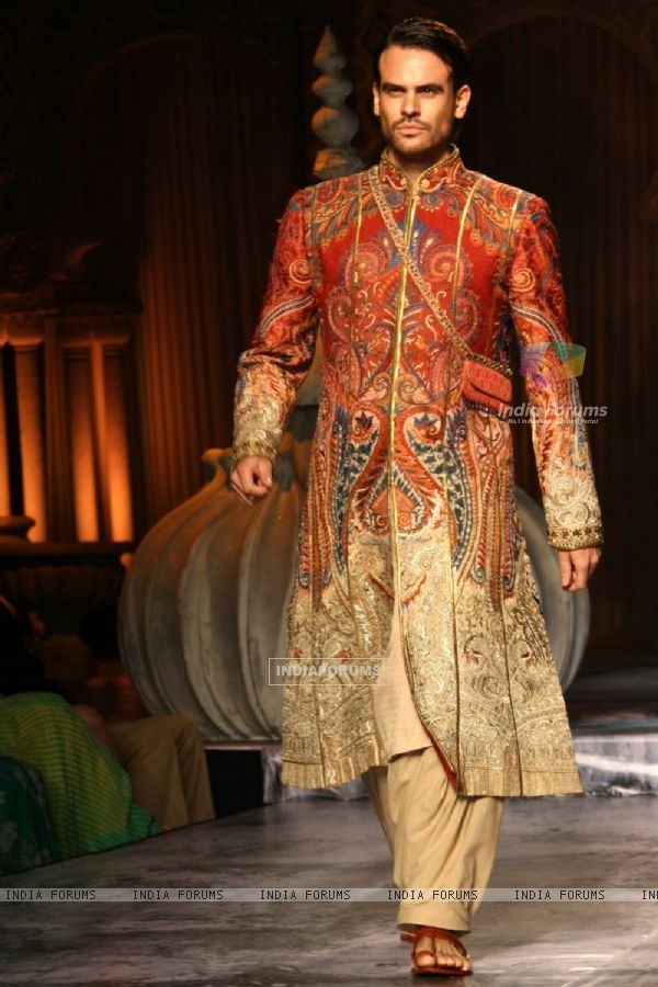 A model showcases a creation by designer JJ Valaya show at the Delhi Couture Week 2012, in New Delhi on Wednesday. .