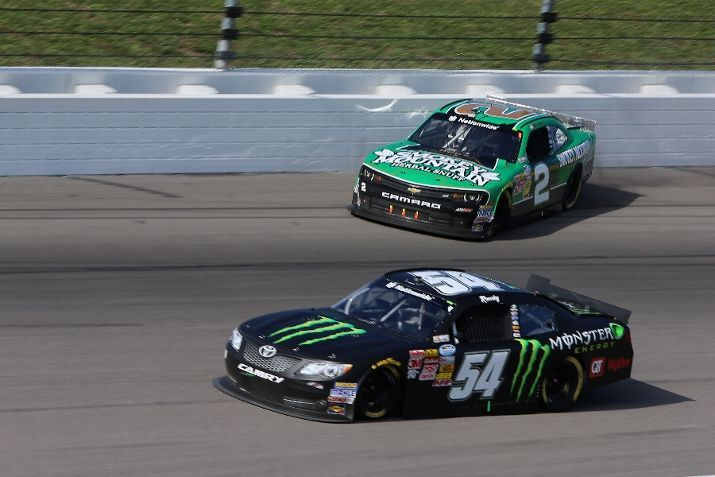 #BrianScott, driver of the #2 Smokey Mountain Snuff #Chevrolet, slides on the track as Kyle Busch, driver of the #54 Monster Energy Toyota, drives by during the #NASCAR #NationwideSeries Kansas Lottery 300 at Kansas Speedway.   Photo by Jerry Markland/Getty Images   #BrianScottNASCAR #RichardChildressRacing #ESPN