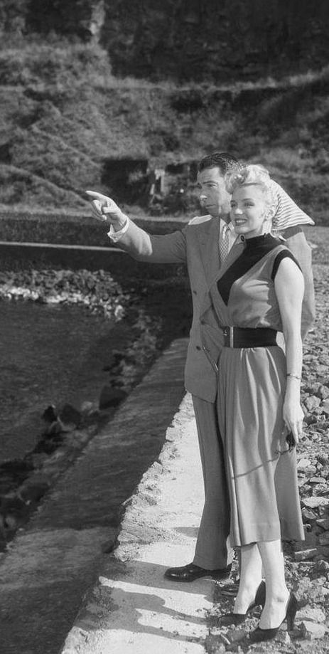 Marilyn and Joe DiMaggio visiting a small fishing village while on their honeymoon in Japan, February 1954.