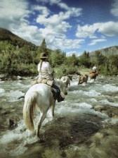 Fording rivers on horseback in Patagonia
